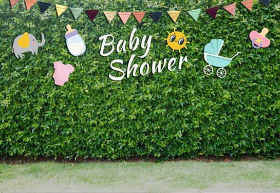 baby shower decorated hedge with thematic decorations and the phrase Baby Shower