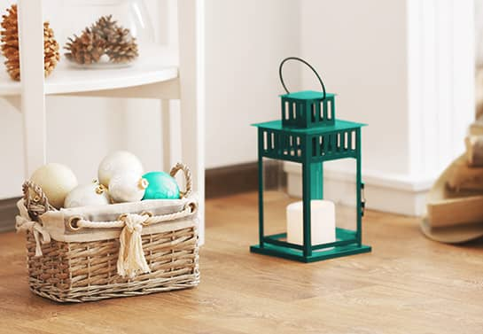 Christmas decoration ideas for office with a basked filled with ornaments