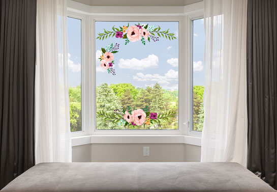 Bay window with flower stickers and white curtains