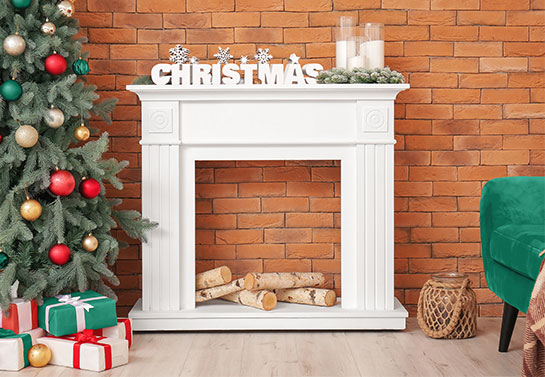 White decoration on the mantelpiece in the style of celebrity Christmas decorations