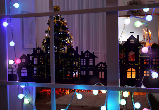 Christmas window decoration idea with a magic winter town view sticker