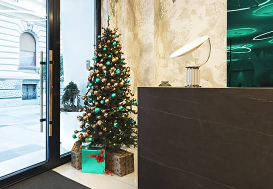 office holiday decorating idea with Christmas tree near the door