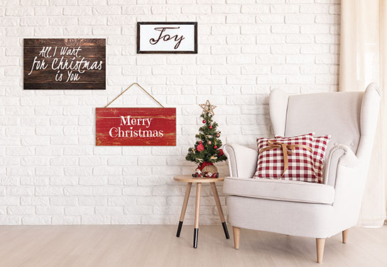 Wooden wall art with Mariah Carey Christmas ornaments' style