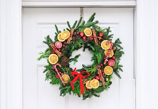 office door wreath for Christmas with dried oranges
