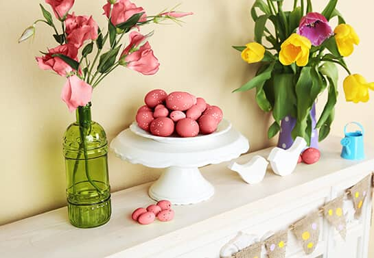 Easter mantel decorating idea with red eggs and flowers