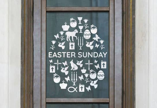 Easter church window decoration idea with holiday-themed elements