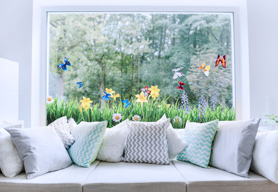 Holiday window idea with adhesive flower prints for Easter