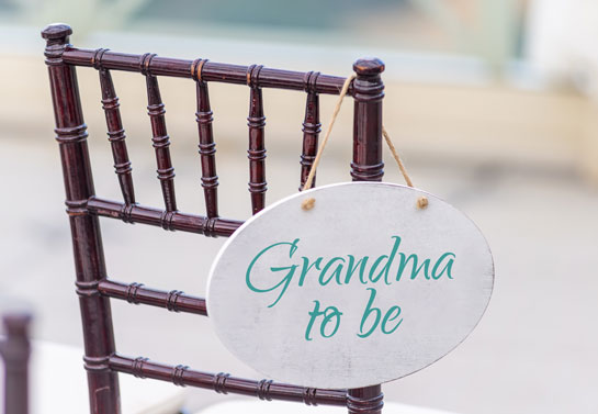 Outdoor baby shower Grandma-to-be decor hanging on chair