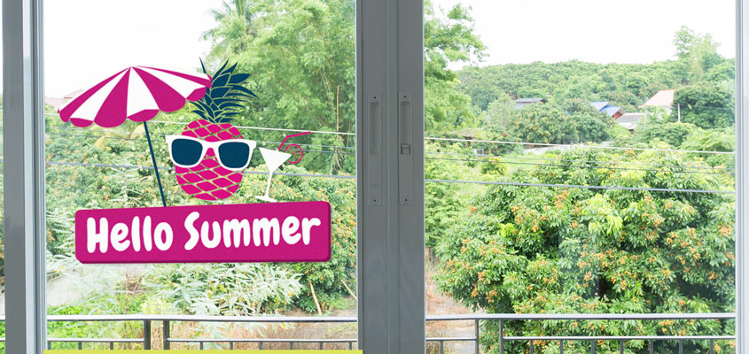 summer themed home window decorating idea with decals