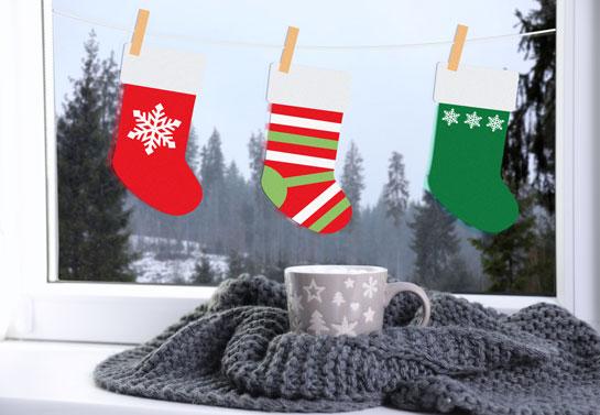 Christmas window decoration idea with Santa stockings