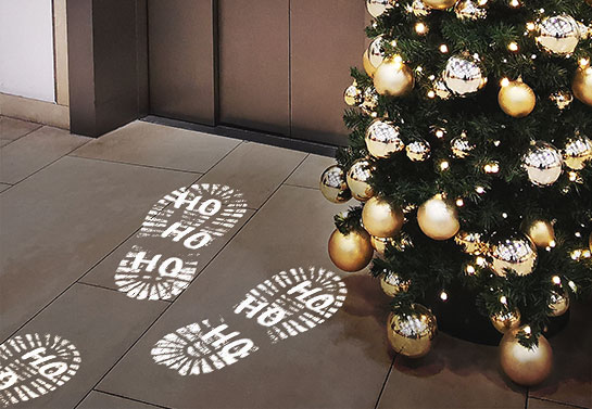 easy Christmas decorations for the office floor with snowy footprints