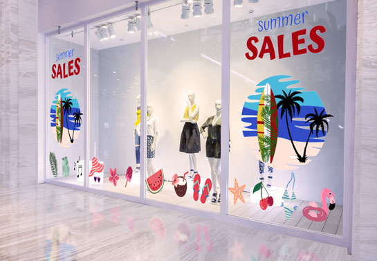 Promotional holiday window decorating idea for summer sales