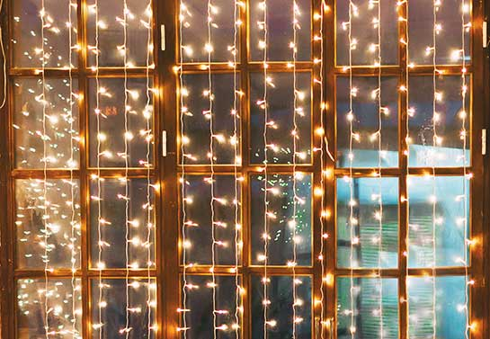 simple office Christmas decoration idea with light cords for windows