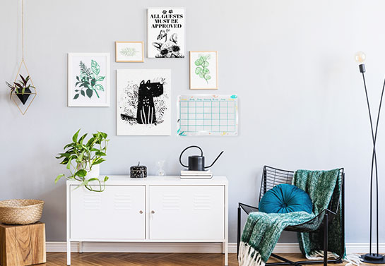 office guest room idea for a gallery wall with artwork and a dry-erase board for notes