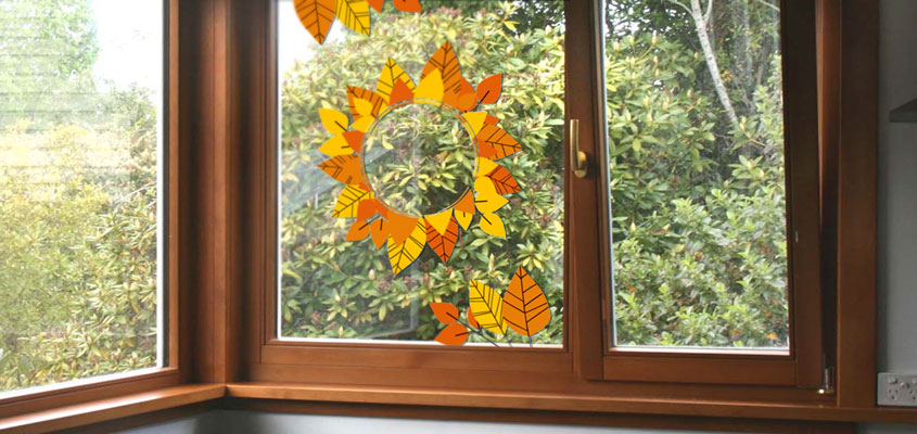 autumn themed home window decorating idea with decals