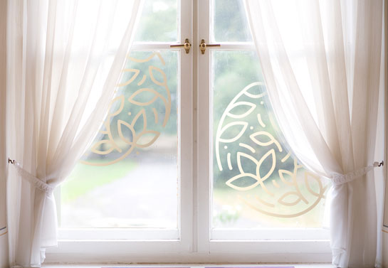 bay window decorating idea with curtains and decals
