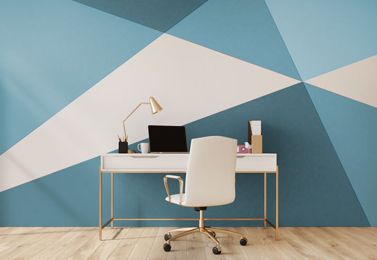 home office in blue color with geometric wall prints