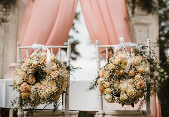 outdoor wedding chair flower decor