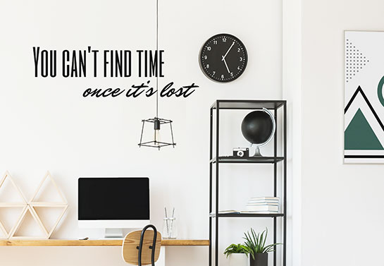 office guest room idea with a decorative wall clock and quote print