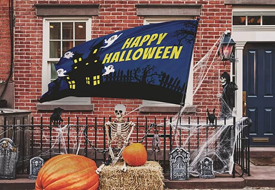 outdoor Happy Halloween flag banner in blue with a ghost house display