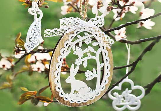 cute Easter decorations in white color hung from the tree