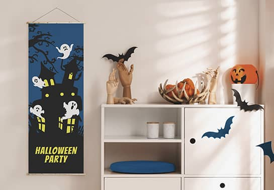 cute Halloween banner design in blue displaying a ghost house