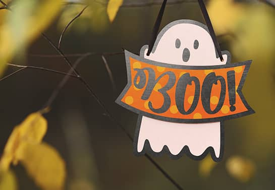 cute Halloween tree sign in white displaying the ghost character