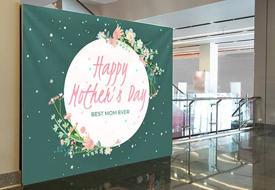 Cute mother's day backdrop idea with flower elements displaying the words Happy Mother's Day