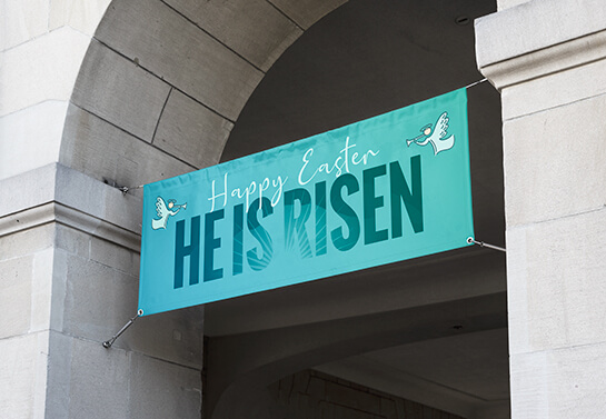 Easter church side wall decoration idea with a banner displaying the words Happy Easter
