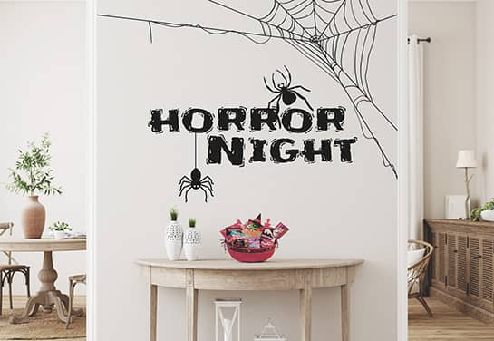 black Halloween wall sign with spider graphics