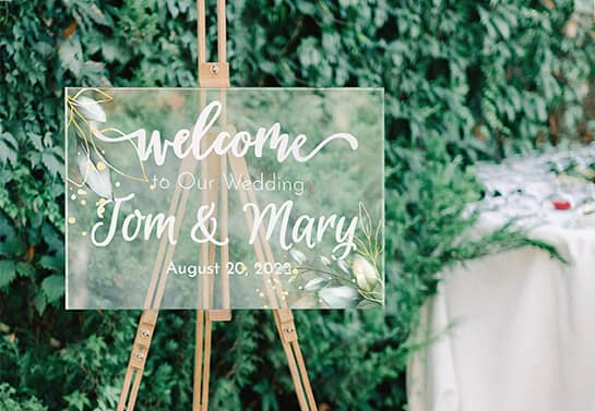 elegant wedding welcome sign idea with floral elements