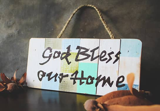 farmhouse wood sign idea multicolored with the phrase God Bless Our Home