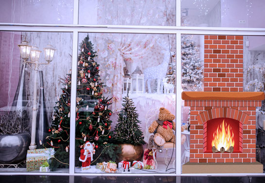 winter themed fireplace window decor for a business window