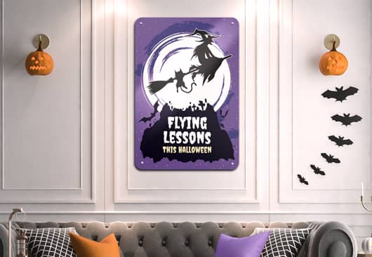 funny Halloween witch sign in purple displayed on the wall