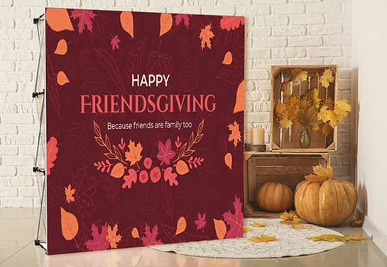 Happy Friendsgiving party backdrop in a deep red color