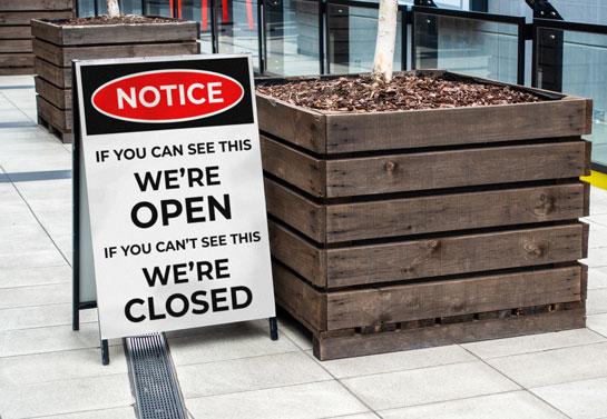 funny open hours sandwich board sign idea