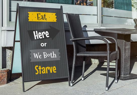 Eat Here Or We Both Starve funny sidewalk sign
