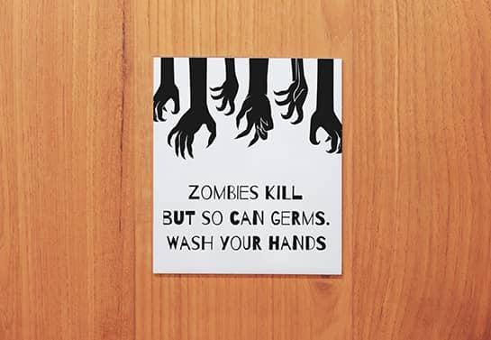 zombie-themed Halloween door sign in white