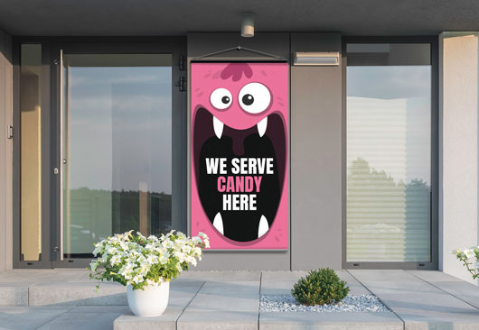cute pink Halloween sign in a large size hung in the front door area