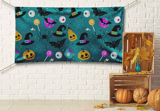 Halloween backdrop idea in greenish colors with a holiday-themed pattern