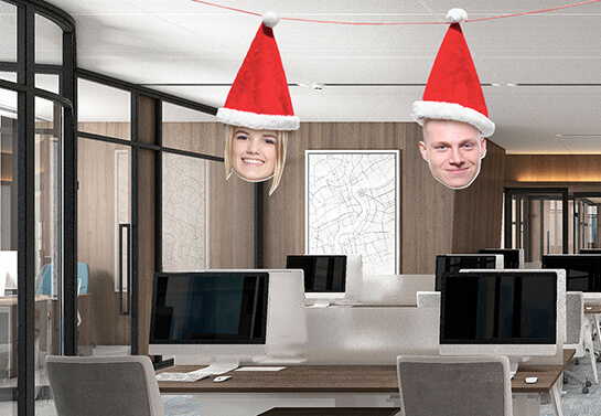 hanging employee photos wearing santa hats