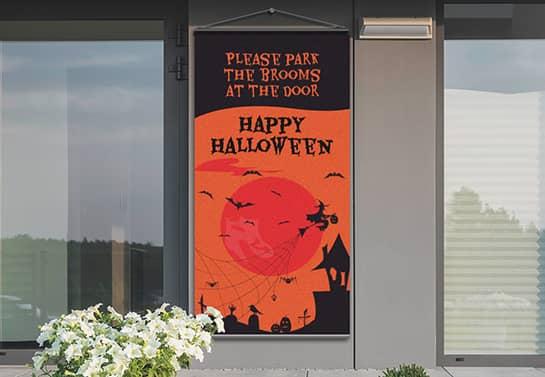 front door Happy Halloween hanging banner in black and orange