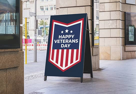free-standing Happy Veterans Day sign displayed at the entrance