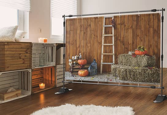 large harvest-themed Thanksgiving backdrop in a rustic room
