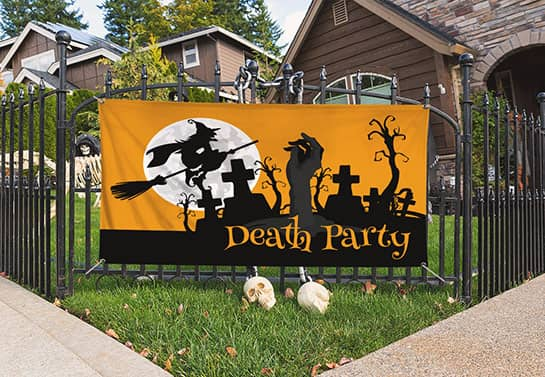 yellow and black Halloween party sign at the front of the house