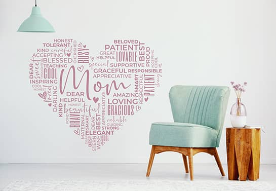 Heart-shaped mother's day backdrop idea displaying different cute words for moms