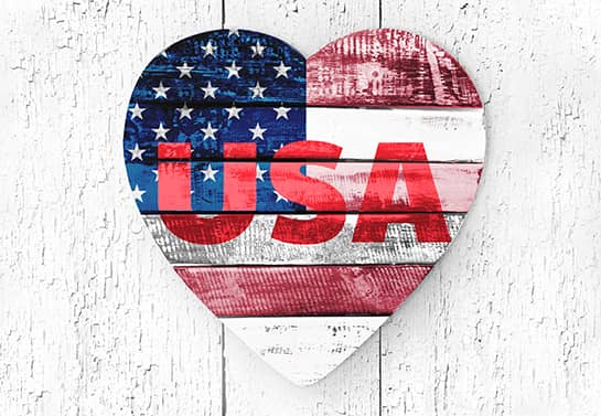 heart-shaped patriotic home decor idea displaying the USA name and flag