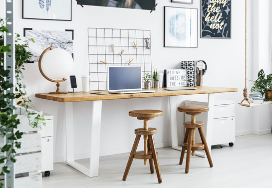 white home office minimalistic look with wooden decor and plants