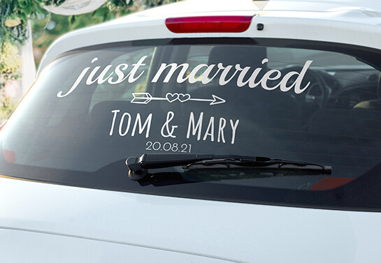 just married sign idea displayed on a car rear window