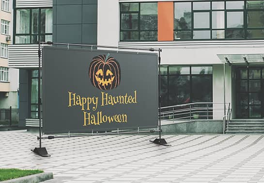 large Halloween party banner in black at the front of an office